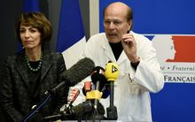 French Social Affairs and Health minister Marisol Touraine (L) and professor Gilles Edan (R)