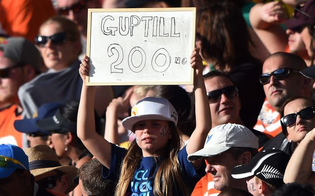 Black Caps fans celebrate Martin Guptill's double century against the West Indies.