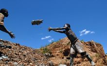 A boy working in an open pit gold mine in Mongwalu, Democratic Republic of Congo, in 2008.