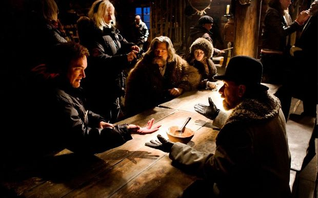 Director Quentin Tarantino (left) works with his cast on the set of The Hateful Eight