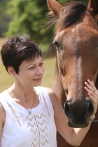 Photo of Johanna Emeney with horse