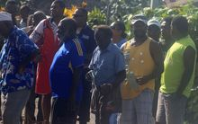 Voters line up outside a polling booth in Port Vila.