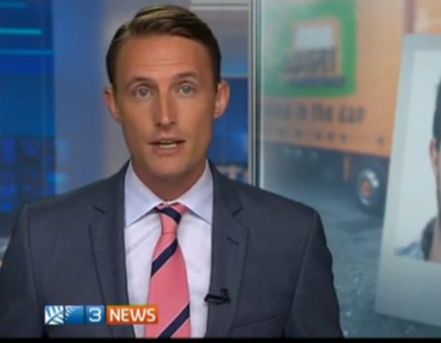Picture of the man's face showing the screen in the run up to the report beside the newsreader.