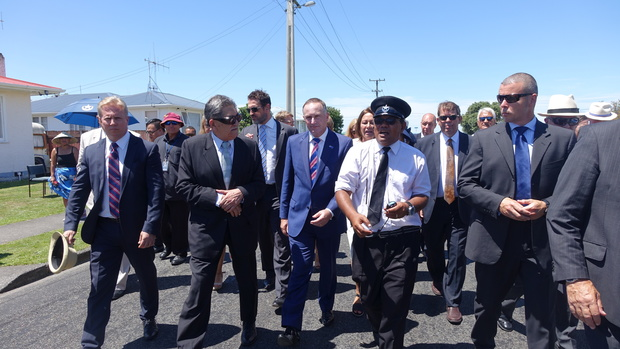 John Key (centre) making his way to the powhiri.