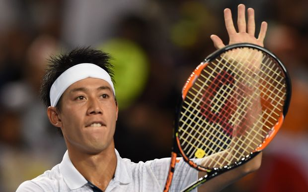 Japan's Kei Nishikori celebrates his win against France's Jo-Wilfried Tsonga on day seven of the 2016 Australian Open in Melbourne, January 24, 2016. AFP PHOTO / GREG WOOD