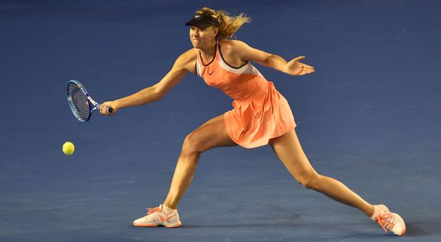 Russia's Maria Sharapova returns against Switzerland's Belinda Bencic on day seven of the 2016 Australian Open in Melbourne, January 24, 2016. AFP PHOTO / PAUL CROCK