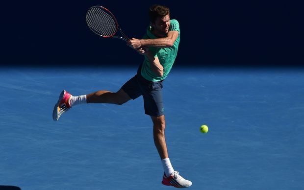France's Gilles Simon returns against Serbia's Novak Djokovic during their men's singles game on day seven of the 2015 Australian Open in Melbourne, January 24, 2016. AFP PHOTO / PAUL CROCK