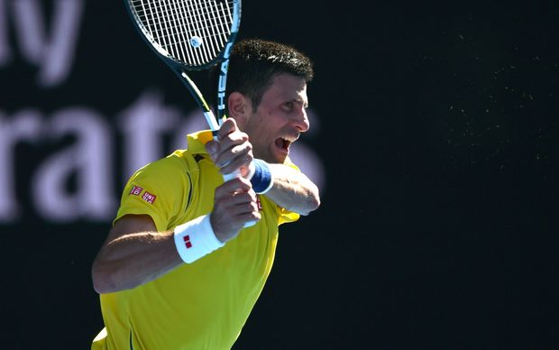Serbia's Novak Djokovic as he fought against France's Gilles Simon on day seven of the 2016 Australian Open in Melbourne on January 24, 2016. AFP PHOTO / PETER PARKS