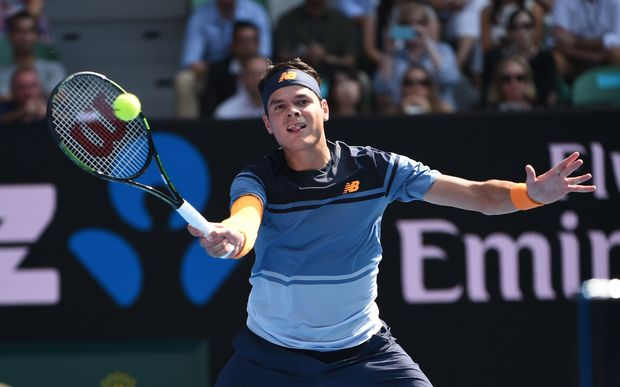 Canada's Milos Raonic plays a forehand return during his men's singles match against Switzerland's Stan Wawrinka on day eight of the 2016 Australian Open, January 25, 2016. AFP PHOTO / WILLIAM WEST