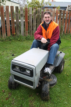 Photo of Ride-On Racer, Andrew Williamson on his lawnmower.