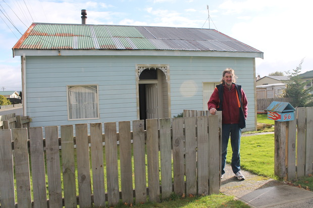 A photo of Andrew Williamson in front of his Milton home.