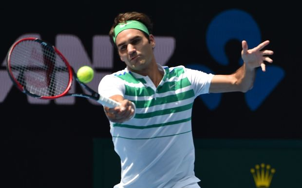 Switzerland's Roger Federer hits a return during his men's singles match against Czech Republic's Tomas Berdych at the 2016 Australian Open, January 26, 2016. AFP PHOTO / SAEED KHAN