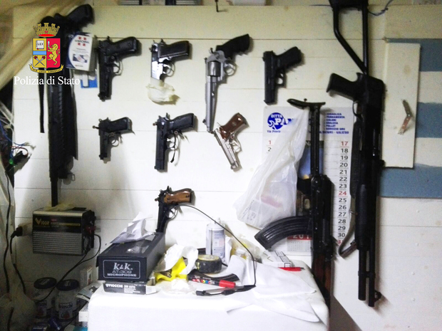 A picture released by the Italian police showing arms found during the anti-mafia operation.
