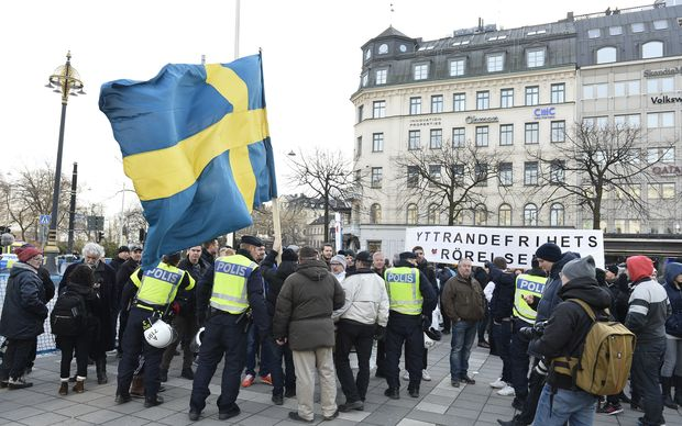 "Police talk to participants of a movement calling itself ""The People's Demonstration"".