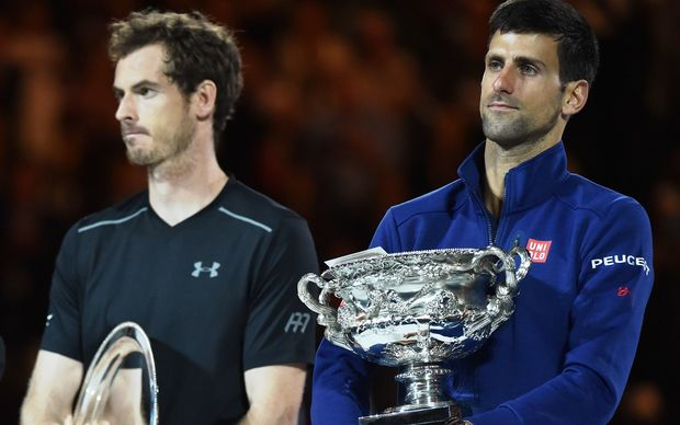 Serbia's Novak Djokovic (L) and Britain's Andy Murray (R) hold their trophies during the prize giving ceremony after Djokovic won their men's singles final on day fourteen of the 2016 Australian Open tennis tournament in Melbourne on January 31, 2016