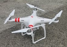 A closeup image Karekare Surf Life Saving Club's new drone, sitting on conccrete outside the club.
