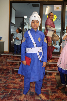 Sikh boy wears the five Ks