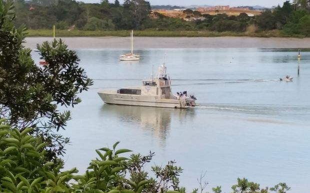 A police boat takes part in the search for the missing swimmer