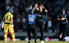 Matt Henry celebrates the wicket of Australia's George Bailey at Eden Park.