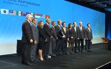 The delegates gather after the signing ceremony