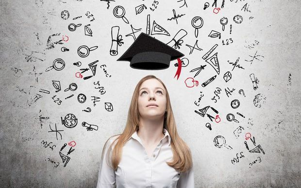 Woman considering education, stock photo.
