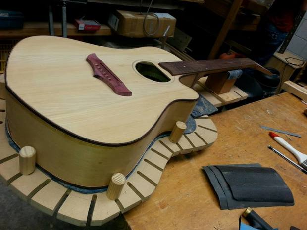 Putting the finishing touches on Sinead O'Connor's guitar