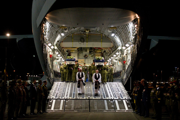 Military officials pay tribute to Lance Corporal Rory Malone and Lance Corporal Pralli Durrer as they are carried off a US Air Force C-17 aircraft.