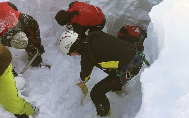Rescuers search for a group of people buried by an avalanche in western Austria.