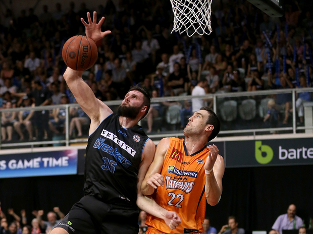 Breakers' Alex Pledger beats Taipans' Matthew Burston to score.
