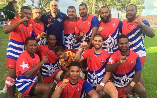 The West Papua Warriors celebrate beating the Philippines development team.