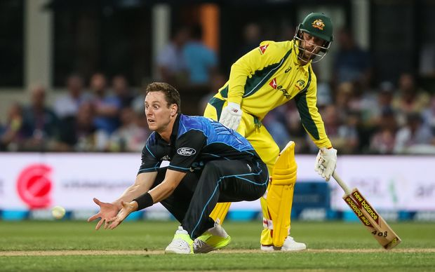 Matt Henry about to complete his controversial caught and bowled of Australian batsman Mitch Marsh.