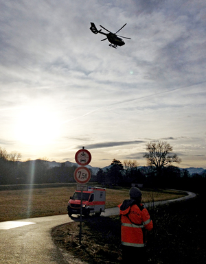A rescue helicopter flies to the site of a train accident on February 9, 2016 near Bad Aibling, southern Germany.