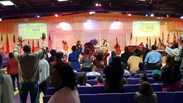 "A Thursday night ""Faith Charge"" service at the United Nations Church International in Richmond, Virginia"