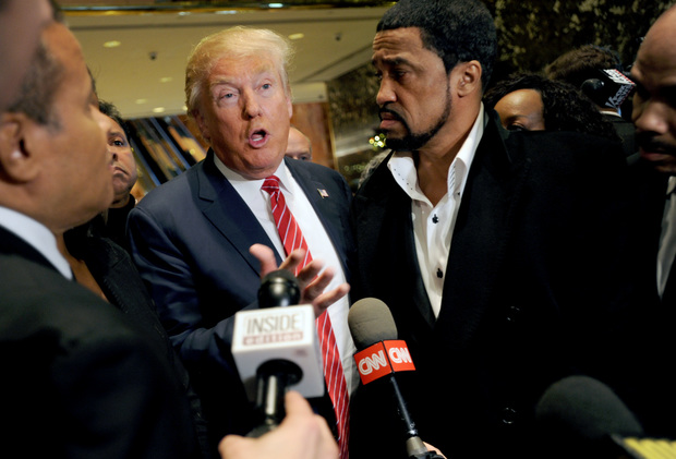 Republican presidential candidate Donald Trump talks to reporters after meeting with African-American religious leaders in New York in November 2015.