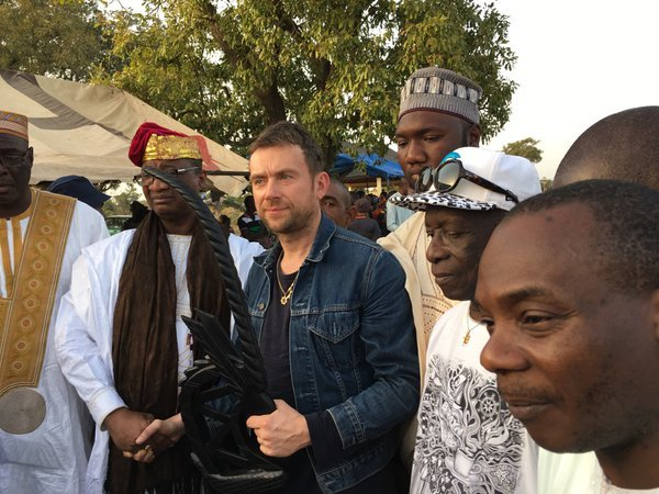 picture of British musician Damon Albarn being granted the status of a local king in the village of Kirina, Mali.
