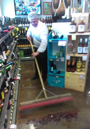 David, a retail worker, mops up a bottle store in Sumner.