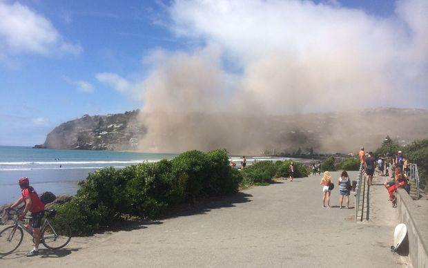 A huge dust cloud follows the collapse of a cliff near Sumner.