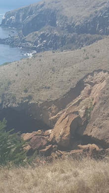 The quake caused a boulder on Godley Heads to break off and slip into the sea.