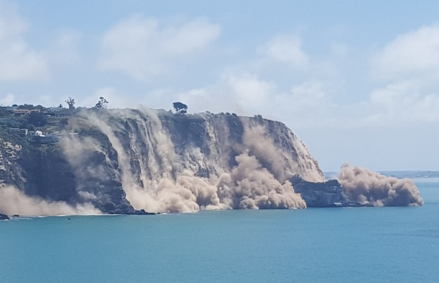 The view from Godley Head Track of a cliff collapsing near Sumner.