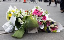 Flowers are left at a memorial to earthquake victims in central Christchurch on March 1, 2011.