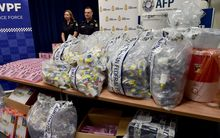 Australian Border Police with the crystal meth found concealed in packaging.