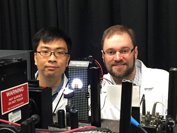 Yingzhuang Ma, left, and Jonathan Halpert are measuring the performance of a solar cell.