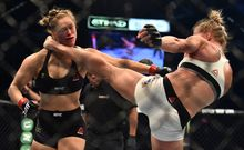 The moment Ronda Rousey (L) was knocked out by Holly Holm (R) at UFC 193 in Melbourne.