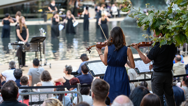 An orchestra plays on the waterfront.