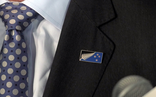 John Key's lapel with a close up of the Kyle Lockwood flag