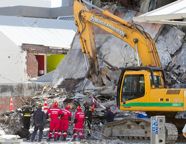 Urban Search and Rescue teams from New Zealand and China work on the wreckage of the CTV building.