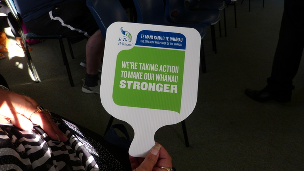 "sign saying ""We're taking action to make our whanau stronger."""