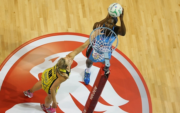 Steel's Jhaniele Fowler-Reid takes a shot at goal while defended by Pulse's Katrina Grant in the ANZ championship netball match, Steel v Pulse, ILT Stadium Southland, Invercargill, New Zealand, Monday, April 14, 2014.