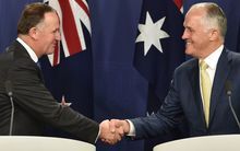 New Zealand Prime Minister John Key (L) and Australia's Prime Minister Malcolm Turnbull shake hands at the joint press conference in Sydney.