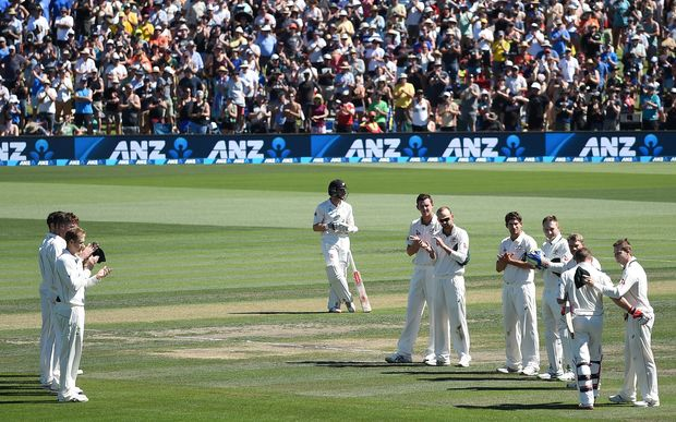 Retiring NZ Captain Brendon McCullum comes to the wicket with a guard of honour.